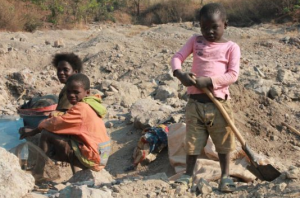 Child workers digging for minerals in the mines