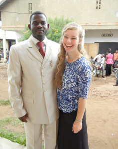 Maddie with pastor James Byensi