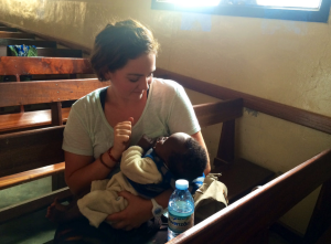 Allí Newell holding one of the youngest members of the Bunia Evangelical Francophone Church